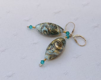 14 karat gold filled and Murano beads for these earrings.