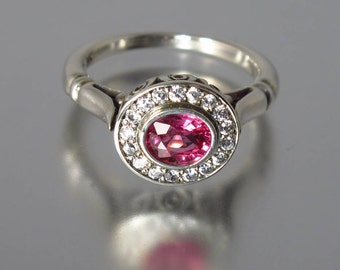 THE SECRET DELIGHT 14k gold oval Pink Sapphire engagement ring