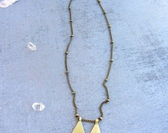 Long chain gold necklace vintage inspired with a pentagonal handmade brass charm.