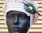 White Colourful Sparkly Crochet Hat with a Green Clasp...