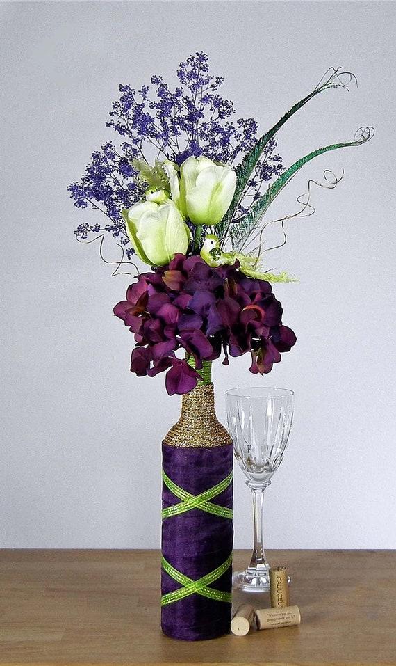 Eggplant purple floral arrangement with hydrangeas by for Wine bottle flower vase