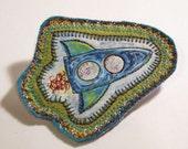 original stitch art brooch - blue rocket ship