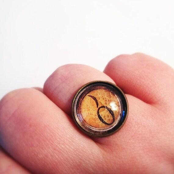 MONOGRAM LETTER TYPOGRAPHY: Zero End Parend Adjustable Glass Typewriter Ring.