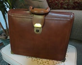 Large Brown Cowhide Leather Brief Case With a Key Latch.