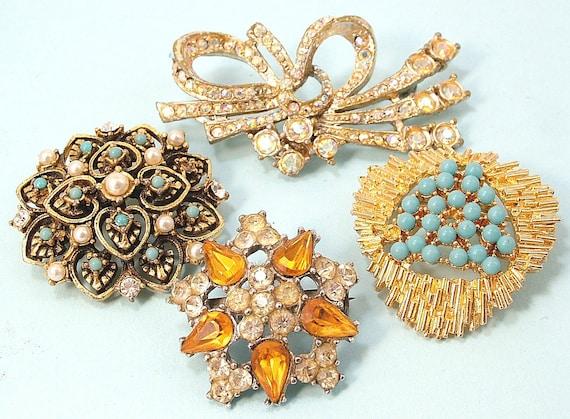 4 Vintage 1950s/ 60s rhinestone/ paste, costume brooches