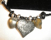 Valentine Braclet 8 inch Leather Braclet with Heart charms of every size
