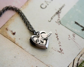 mouse. necklace. silver ox color