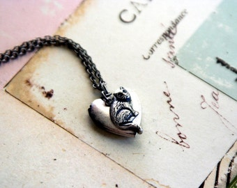 cat. locket necklace. silver ox jewelry