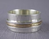 Personalized hammered spinner ring made from sterling silver and solid 10k gold