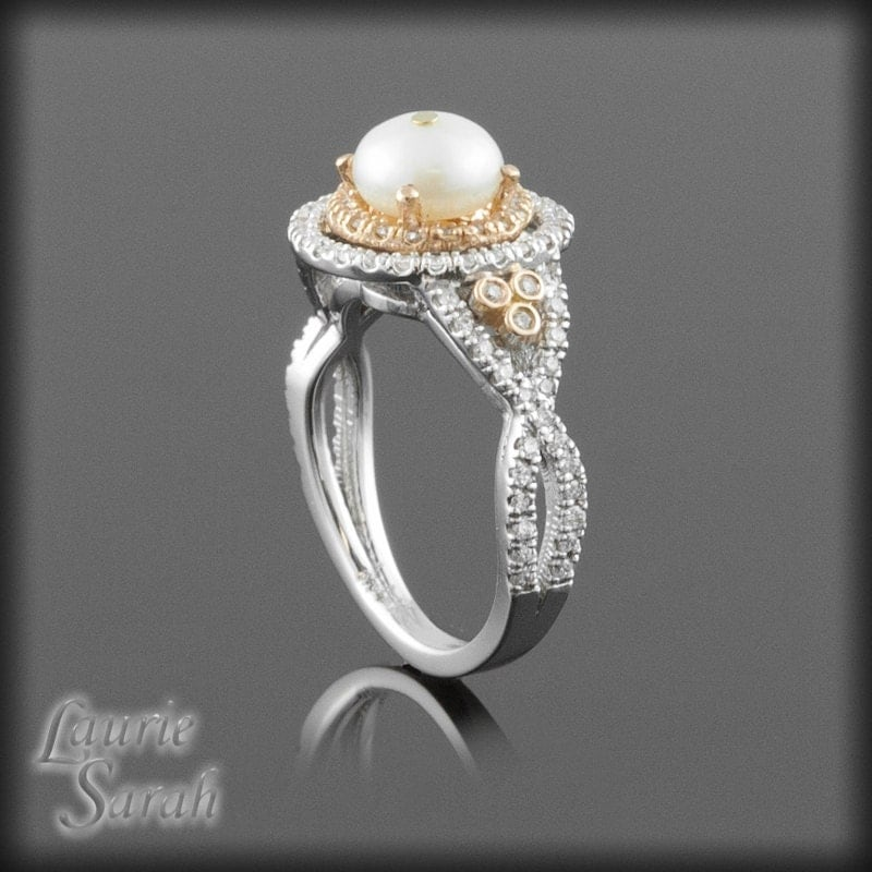 pearl and halo engagement ring in by