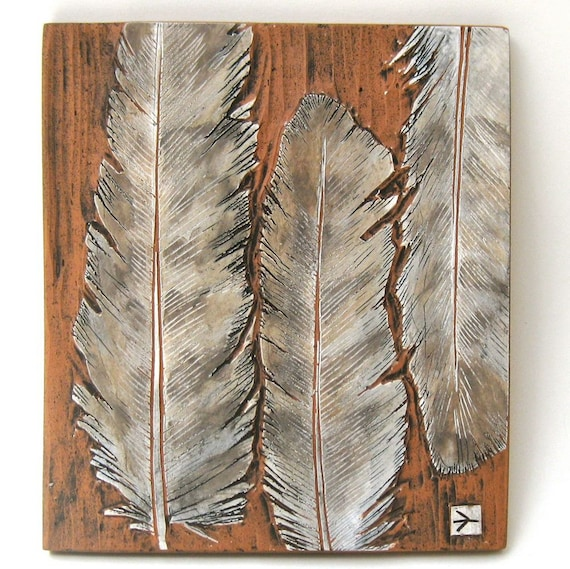hand carved ceramic art tile hawk feathers