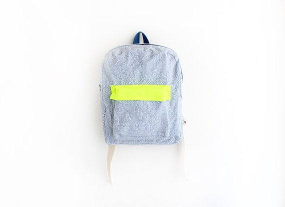 Blue geometrical print backpack with neon yellow pouch