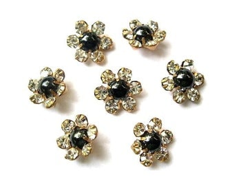 7 Antique vintage Swarovski flower cabochon clear and black crystals  mounted in brass setting