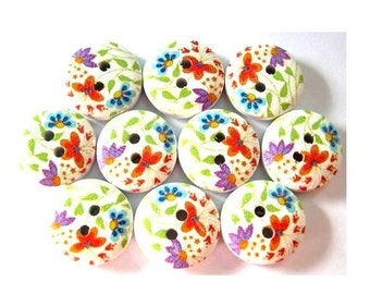 10 Wood buttons 15mm flowers in orange, blue, purple on white surface