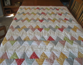 Chevron Quilt made with Reunion and Hometown fabrics from Sweetwater for Moda in four sizes