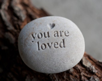 You are loved - engraved message beach pebble by sjEngraving