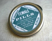 round pill box with vintage female pills phamaceutical label
