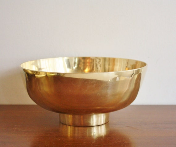 Large vintage brass bowl with footed base