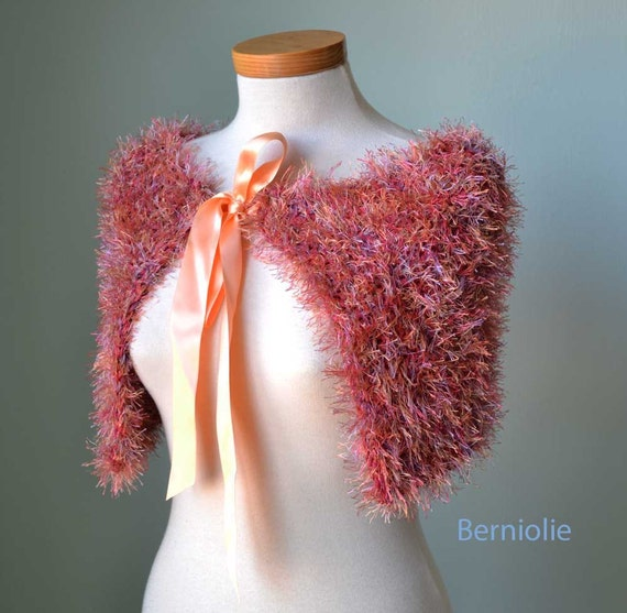 Elegant peach knitted capelet with a satin tie ribbon A47