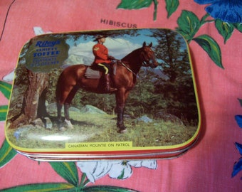 canadian mountie on patrol  toffee tin