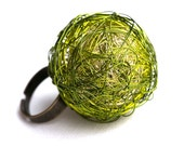 handmade wire ball ring bead in forest green, lime green and champagne multicolored on adjustable ring blank really lightweight