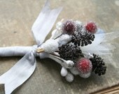 winter white cranberry red and silver glittered stamen boutonniere