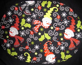 Oval placemats with snowmen, reverse is ghosts, set of 4