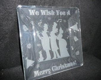 Christmas etched plate with carolers.