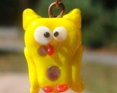 yellow lampwork owl earrings with purple/white glass bead stack