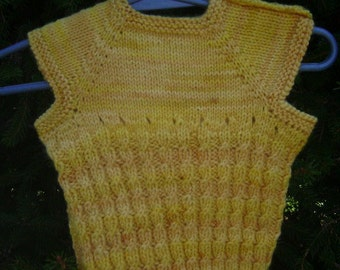 Yellow hand knit wool baby's vest