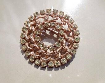 Vintage gold brooch green rhinestones