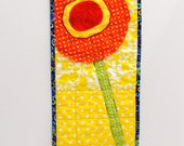 poppy wall quilt- single stem bright orange, yellow and red on yellow and white background