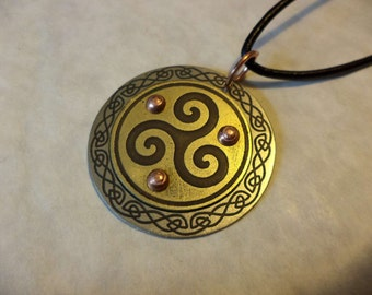 Etched nickel silver and brass celtic knot pendant