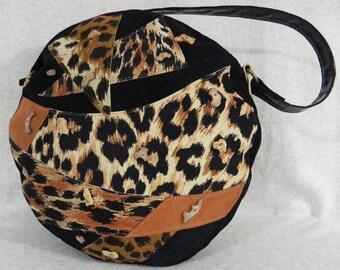 Hatbox purse with animal print by Opulent Handbags