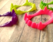 set of four plastic vampire fangs