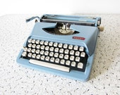 vintage Royal Parade typewriter / mid century baby blue manual portable typewriter with case