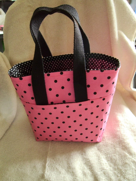 pink and black polka dot tote bag