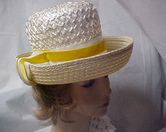 White straw high crown hat with designer label and gold ribbon band-size is 22 inches