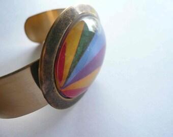 Rainbow cuff bracelet. Abstract rainbow graphic. Modern gold brass bracelet cuff with handmade glass pendant.