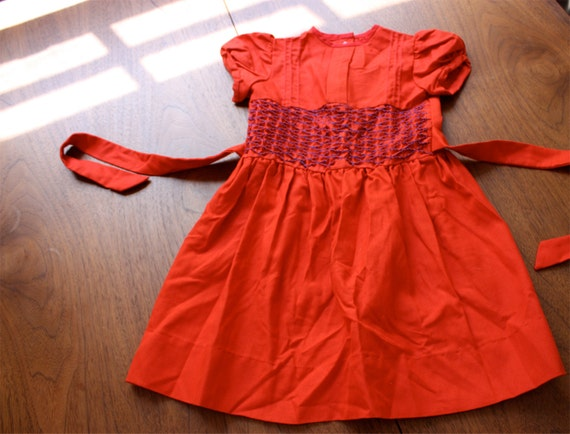 Child's Dress in Red with Smocking and other precious details