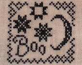 Completed Cross Stitch BOO With Moon and Quilted Stars
