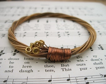 Recycled Acoustic Guitar String Bracelet bronze colored with brass ball ends attached Mens or Womens Unique handmade gift