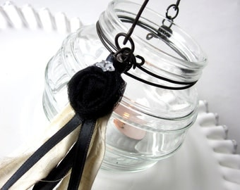 Glass Hanging Candle Holder with Black Rosette and Ribbon