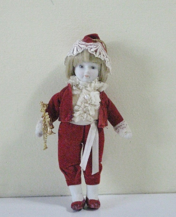 Vintage Christmas Victorian Doll Ornament Red Velvet Outfit Ruffles and Pearl with Gold Horn Instrument Porcelain Face Hands and Feet