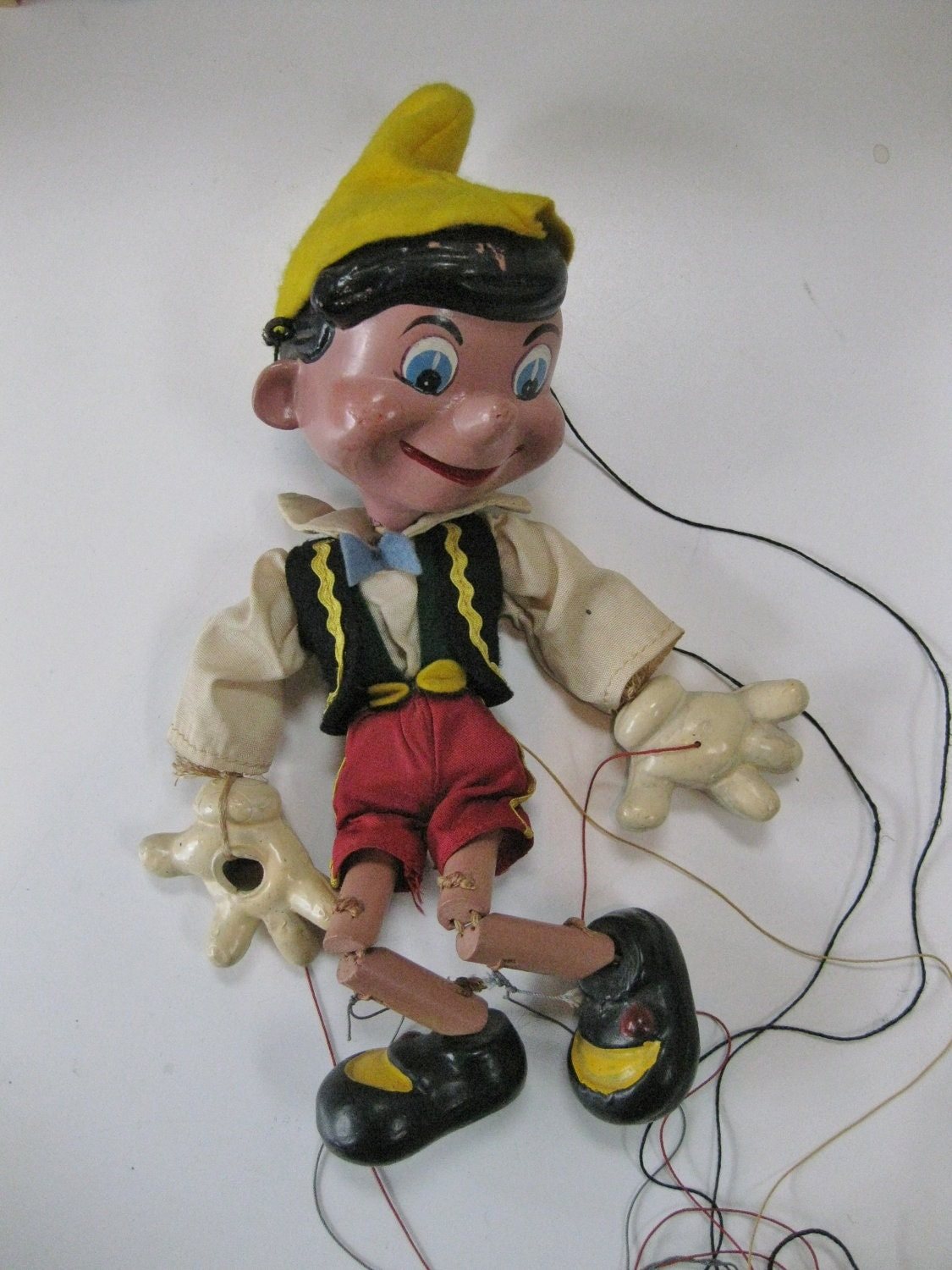 Vintage Pinocchio Marionette Puppet Composition with Fabric