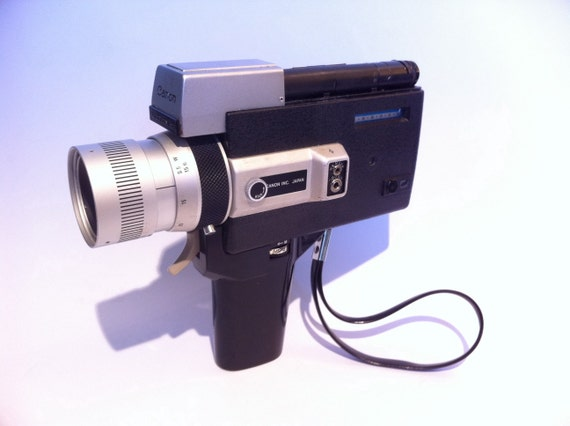 Vintage Bell & Howell Canon auto zoom 518 Super 8 movie video camera.