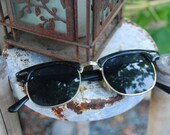 Black and gold rayban style sunglasses