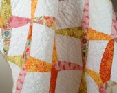 Reduced price Dresden Wedge Quilt in orange, pink, yellow, and tan for baby girl.