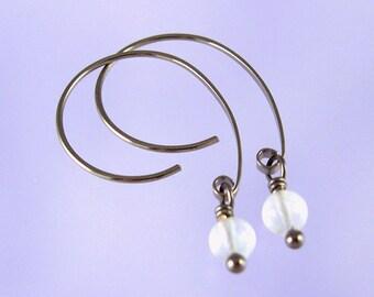 Niobium earrings: Moonstone beads on Apostrophe earwires