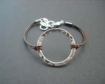 Erratically Hammered Hollow Center Round hoop bracelet - sterling silver plated
